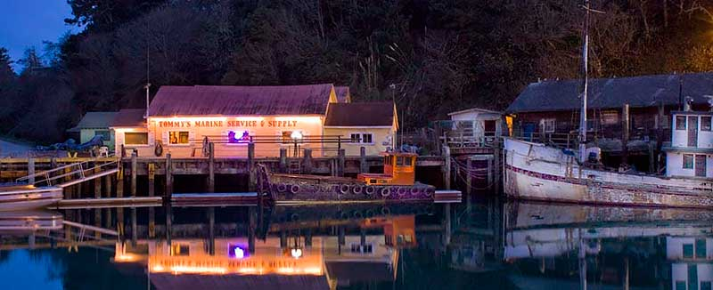 Tommy's Marine Service in Noyo Harbor at night